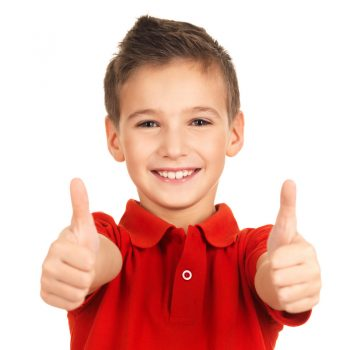 Little boy smiling with thumbs up