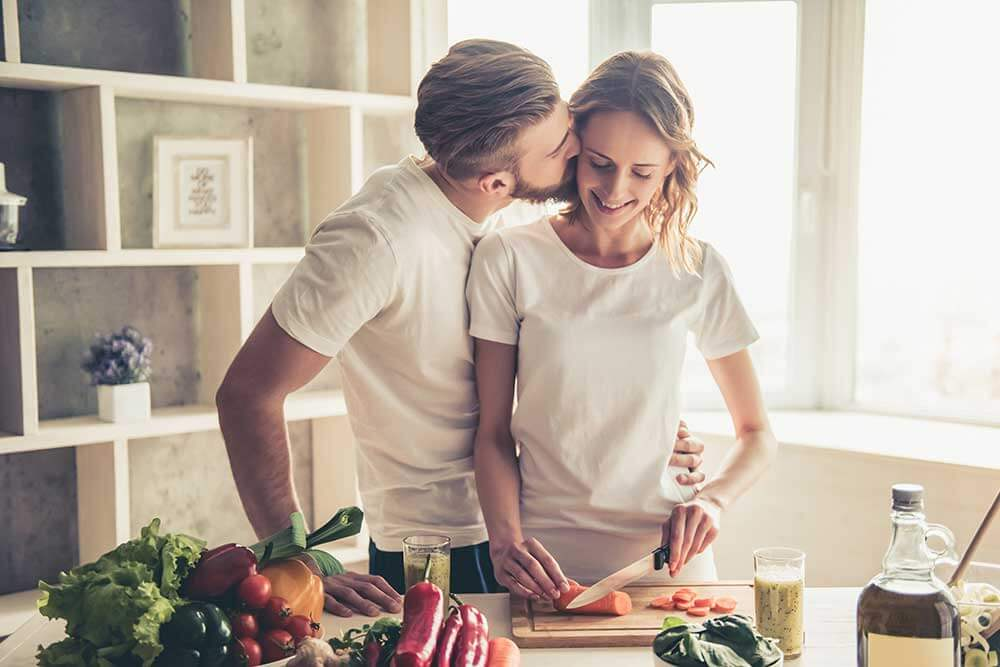Happy young couple in the kitchen